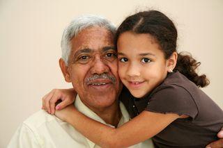 Girl hugging grandpa