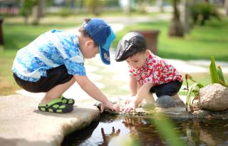 Kids by pond