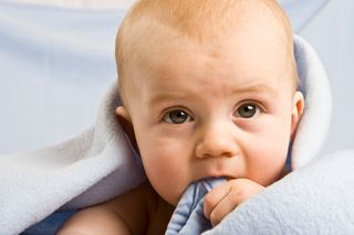 Eating blanket baby