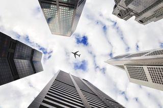 Plane in between buildings
