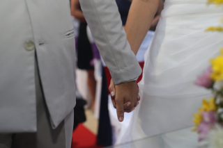 Married holding hands