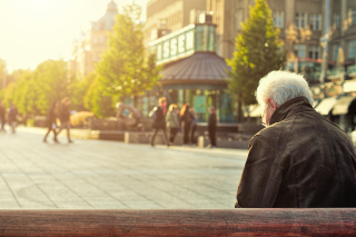Man-sitting-on-wooden-bench-wearing-black-leather-jacket-1377055