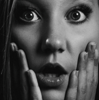 Grayscale-portrait-photo-of-shocked-woman-1201758
